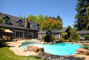 Traditional Swimming Pool with French doors, exterior stone floors, Pool with hot tub