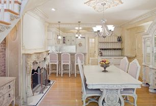 Traditional Dining Room with six panel door, Chandelier, Laminate floors, Fireplace, metal fireplace, Crown molding