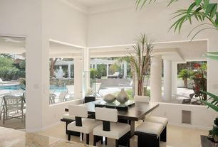 Modern Dining Room with Columns, Concrete tile , Silver Large Metallic Ceramic Vase, Crown molding, specialty door