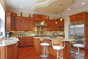 Traditional Kitchen with Raised panel, U-shaped, Pendant light, Simple Granite, Built In Refrigerator, can lights, Wall Hood