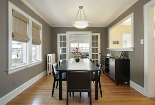 Modern Dining Room with flush light, Ikea stornas table, French doors, Crown molding, Laminate floors