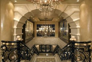 Mediterranean Staircase with Chandelier, Cathedral ceiling, Glass panel door, Carpet