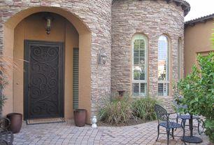 Mediterranean Front Door with exterior tile floors, Arched window, Louvered door