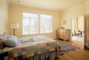 Traditional Guest Bedroom with six panel door, Hardwood floors, Crown molding, Standard height, Casement, Paint 1, can lights