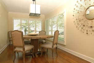 Contemporary Dining Room with Crown molding, flush light, Laminate floors