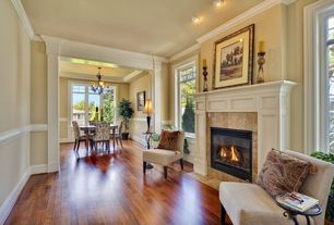 Traditional Living Room with French doors, stone fireplace, Standard height, Transom window, can lights, Fireplace, Casement