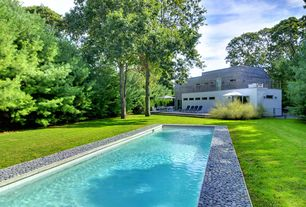 Modern Swimming Pool with Gate, Lap pool, Fence, exterior stone floors