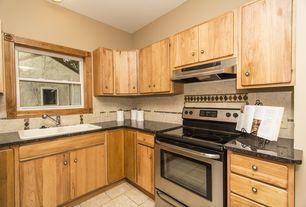 Craftsman Kitchen with European Cabinets, Limestone Tile, flush light, limestone tile floors, Inset cabinets, Stone Tile