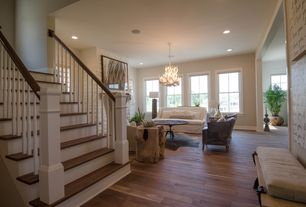 Contemporary Living Room with Wood stair treads, Chandelier, Hardwood floors
