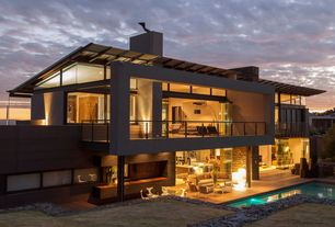Traditional Exterior of Home with Fence, Outdoor pool, Outdoor seating, Large picture windows, Balcony, Outdoor kitchen
