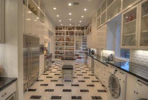 Traditional Kitchen with Custom hood, Vinyl floors, Soapstone counters, European Cabinets, Glass panel, Kitchen island, Flush