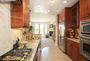 Craftsman Kitchen with Stone Tile, limestone tile floors, European Cabinets, Raised panel, Galley, Simple granite counters