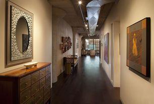 Eclectic Hallway with Standard height, Exposed beam, Built-in bookshelf, specialty window, Hardwood floors, can lights