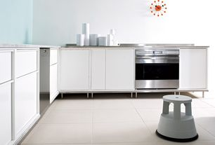 Contemporary Kitchen with Telechron pixel clock, limestone tile floors, Flush, Flat panel cabinets, L-shaped