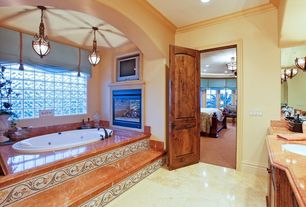 Mediterranean Master Bathroom with Complex granite counters, flat door, Master bathroom, Stained glass window, Bathtub