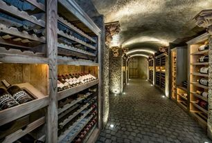Rustic Wine Cellar with Standard height, Built-in bookshelf, can lights, slate floors
