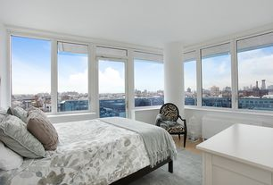 Contemporary Guest Bedroom with picture window, Standard height, Wainscotting, Hardwood floors, Transom window, French doors