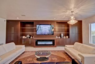 Contemporary Living Room with Built-in bookshelf, Chandelier, simple marble tile floors