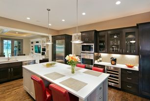 Modern Kitchen with Wine refrigerator, L-shaped, full backsplash, wall oven, Quartz counters, Framed Partial Panel, Paint 1