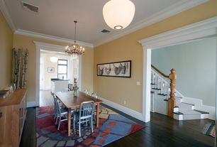 Country Dining Room with Paint, flush light, Crown molding, Standard height, Chandelier, Hardwood floors