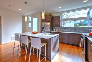 Contemporary Kitchen with picture window, specialty door, Corian counters, Standard height, Flush, Hardwood floors, Wall Hood