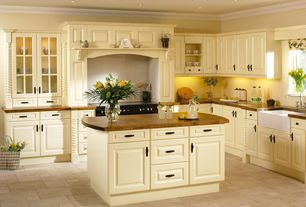 Traditional Kitchen with Casement, Standard height, Farmhouse sink, Framed Partial Panel, limestone tile floors, L-shaped