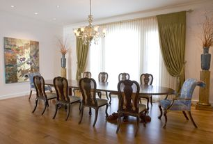 Eclectic Dining Room with Chandelier, Standard height, can lights, Hardwood floors, Crown molding