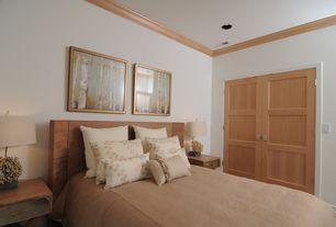 Modern Guest Bedroom with can lights, Crown molding, French doors, Standard height