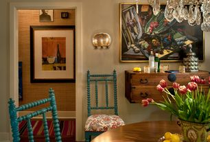 Eclectic Dining Room with Wall sconce, Chandelier, Built-in bookshelf