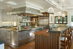 Craftsman Kitchen with Wood counters, Crown molding, Box ceiling, Kitchen island, Breakfast bar, Flat panel cabinets, Flush