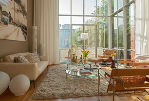 Contemporary Living Room with High ceiling, Transom window, French doors, Hardwood floors