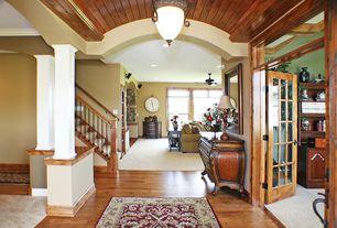 Craftsman Hallway with French doors, Transom window, Laminate floors, flush light, Ceiling fan, Standard height