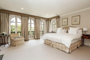 Traditional Master Bedroom with Crown molding, Paint, Carpet, French doors, Arched window, Standard height, can lights