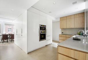 Modern Kitchen with stone tile floors, limestone tile floors, double wall oven, Caesarstone Classico Collection, Clamshell