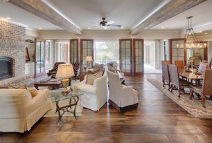 Traditional Great Room with Crown molding, Chandelier, French doors, Exposed beam, Hardwood floors, Built-in bookshelf