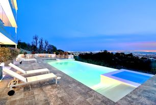 Contemporary Swimming Pool with Pool with hot tub, exterior stone floors, Raised beds