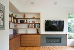 Contemporary Living Room with Maple - Cinnamon 2 1/4 in. Solid Hardwood Strip, Built-in bookshelf, Hardwood floors