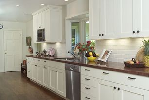 Traditional Kitchen with six panel door, Copper counters, Undermount sink, can lights, Bay window, Standard height, One-wall