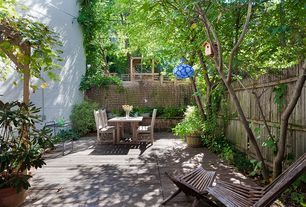 Eclectic Deck with Raised beds, exterior stone floors, Fence, Pathway