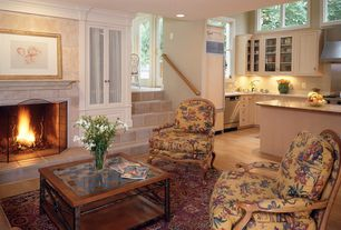 Traditional Living Room with stone fireplace, Laminate floors, Crown molding, Sunken living room