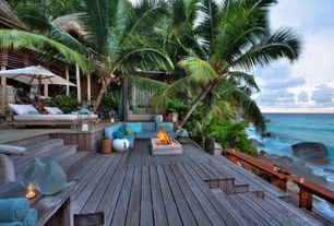 Tropical Deck with Weathered cedar decking, Fire pit, Teak Chaise Lounge, Thos. baker 11' bamboo market umbrella