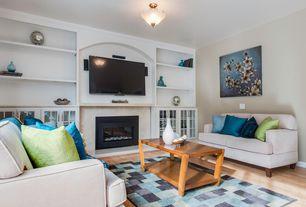 Contemporary Living Room with Hardwood floors, flush light, Built-in bookshelf, stone fireplace