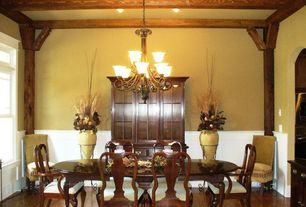 Country Dining Room with Chandelier, Transom window, Wainscotting, Exposed beam, Chair rail, Laminate floors