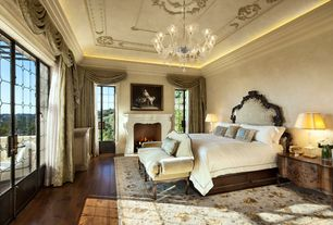 Traditional Master Bedroom with French doors, Hardwood floors, Paint 1, Cement fireplace, Fireplace, Standard height