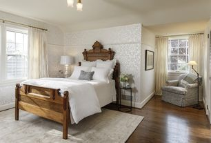 Traditional Guest Bedroom with Hardwood floors, Louvered door, Standard height, flush light, double-hung window