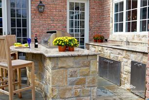 Traditional Patio with picture window, Pathway, Outdoor kitchen, Teak outdoor barstool, French doors, exterior stone floors