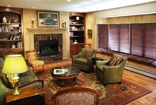 Traditional Living Room with Standard height, stone fireplace, Built-in bookshelf, Fireplace, Hardwood floors, can lights