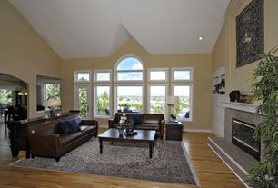 Traditional Living Room with stone fireplace, Cathedral ceiling, can lights, picture window, Casement, Transom window