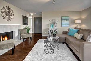 Contemporary Living Room with Hardwood floors, flush light, Medallion fleur-de-lis 3d metal wall decor, Lattice Side Table