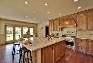 Traditional Kitchen with Board and batten, Granite countertop, Simple granite counters, Glass panel door, Breakfast nook